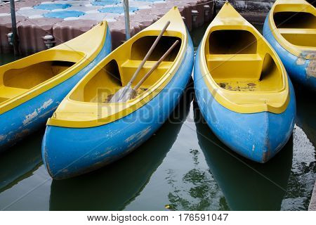 Canoes and Kayaks / Group of canoes and kayaks on lake