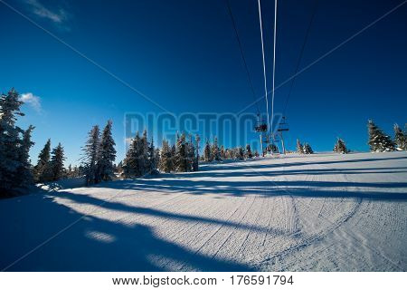 Skiers Ride Chairlift.