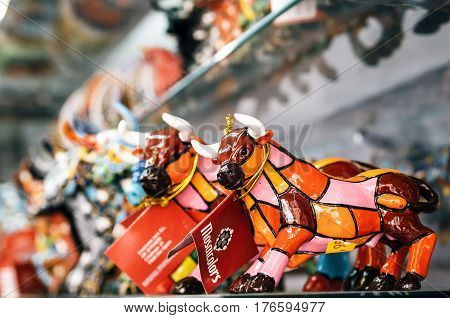 Barcelona Catalunia Spain - May 30 2015: Multicolored mosaic figurine of bull in Gaudi style. Spanish traditional gifts in the souvenir shop.