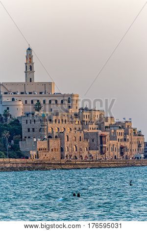TEL AVIV, ISRAEL - MAY 22, 2016: View of Jaffa old city at sunset from the beach.