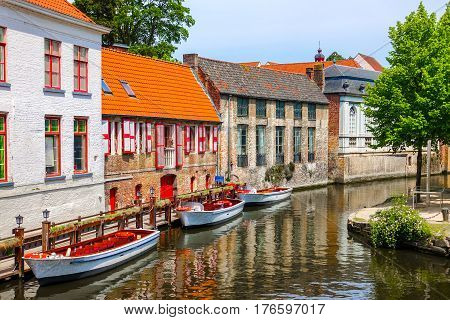 Historic medieval buildings with beautiful canal in the old town of Bruges (Brugge), Belgium