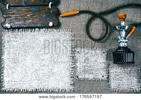 Template with hookah, dark wood signboards and white burlap squares as frames on gray burlap background. Wooden title bar. Rustic style flat pattern