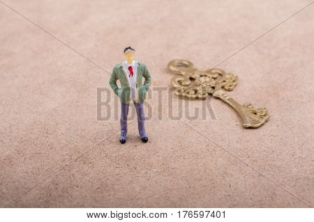 Figurine Standing By A Retro Styled Key