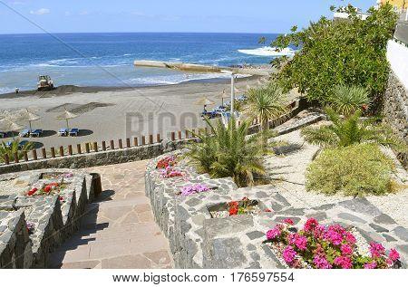 Callao Salvaje Tenerife Canary Islands Spain Europe - June 18 2016: Bulldozer on the volcanic sand on Playa de Ajabo beach