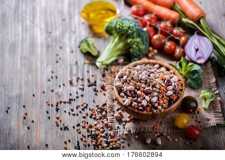Lentils and beans in bowl vegan and vegetarian cooking ingredients with vegetables healthy food clean eating vegan protein