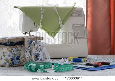 Sewing machine on white table in workshop