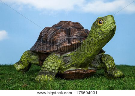 A yard turtle accent statue for outdoor decoration