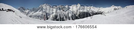 Winter Panorama Of A Mountain Landscape, Snow-capped Peaks And Slopes.