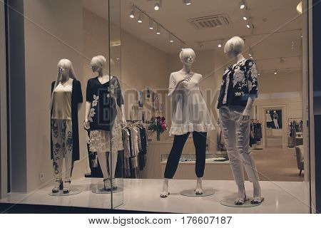Group of female mannequins in a shop window. Fashion