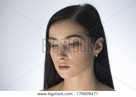 Beautiful Girl. Portrait Of A Girl In Makeup Beauty On A White
