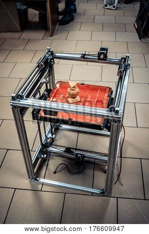 3d printer general plan, 3d printer construction. Automatic three dimensional 3d printer performs plastic yellow colors modeling in laboratory.