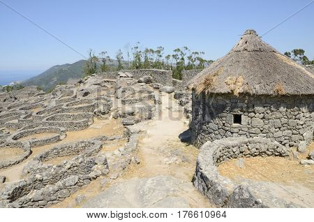 Prehistoric reconstructed house in the remains of a celtic settlement in Santa Tecla Mount in Galicia Spain.