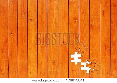Wooden fence with missing puzzle elements. Construction assembling concept.