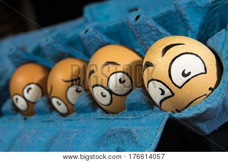 Four frightened egg faces waiting to be cooked