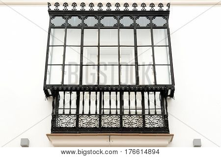 Traditional balcony of historic house in downtown Cordoba, Spain