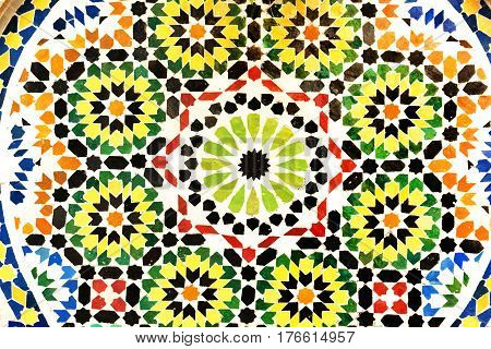 Detail of colorful wall fountain in traditional Spanish courtyard in Cordoba