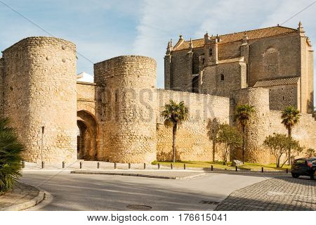 City gates, walls and church of Holy Spirit in historic town Ronda, Spain