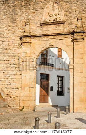 City gates and stone walls in historic town Ronda, Spain