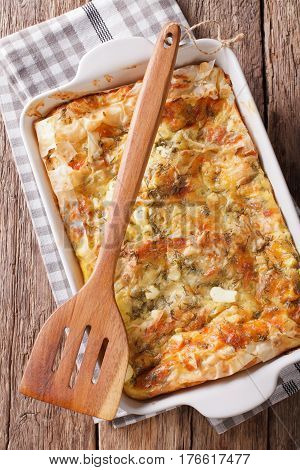 Balkan Food: Serbian Pie Gibanica With Cheese, Eggs And Greens Close-up. Vertical Top View