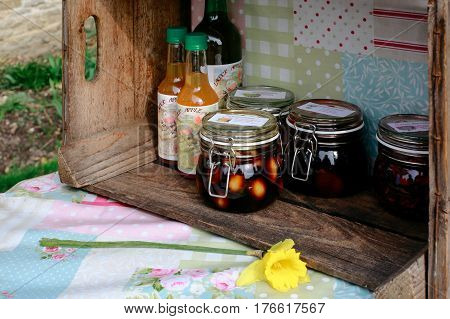 LACOCK, UK - MARCH 11, 2017: Homemade juice, pickles and jam for sale in small village of Lacock, England. Buyer are asked to pay for products into honesty box.