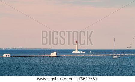 Odessa Red And White Lighthouse In Bright Sunny Summer Day In The Middle Of The Black Sea. Blue Sky