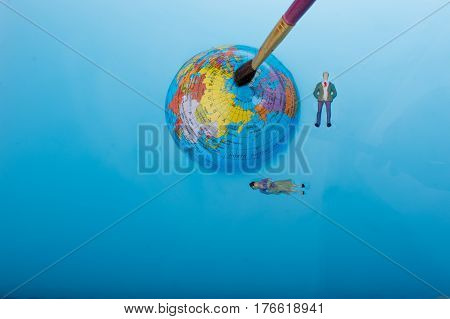 Brush And  Little Globe With Floating Figurines