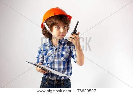 Little funny foreman looks up and says over the radio. Gray background.
