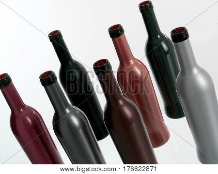 Bodegon de Botellas de vidrio de diferentes colores