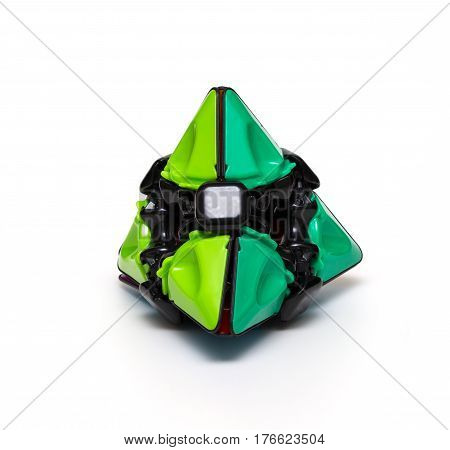 Rubik's pyramid isolated on the white background