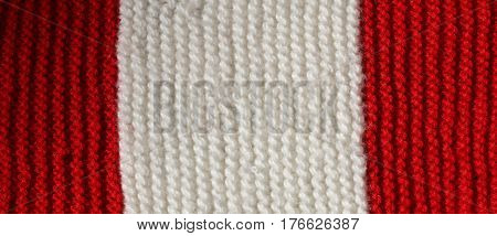 Red And White Wool Texture Of A Winter Dress Made By Hand