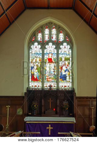 LEWES GREAT BRITAIN - FEB 25 2017: Beautiful colorful church window in St Michael's church in Lewes east Sussex in Great Britain February 25 2017 in Lewes Great Britain.