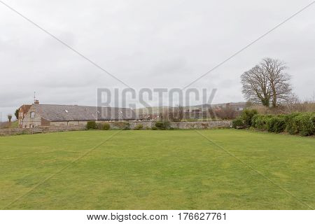 LEWES GREAT BRITAIN - FEB 25 2017: Large greensward and typical buildings in the countryside of England. February 25 2017 in Lewes Great Britain.