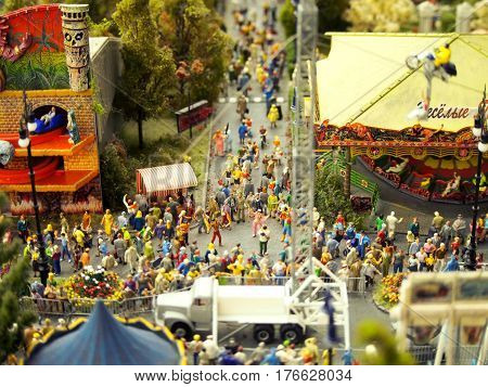 Miniature model of people at a street fair or carnival.