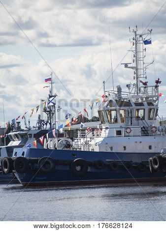 Russian naval ship with flags flying in Kronstadt Russia.