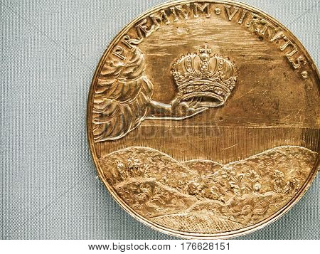 A golden Russian commemorative coin for coronation.