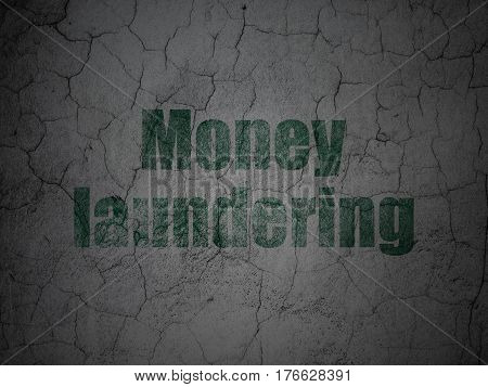 Currency concept: Green Money Laundering on grunge textured concrete wall background