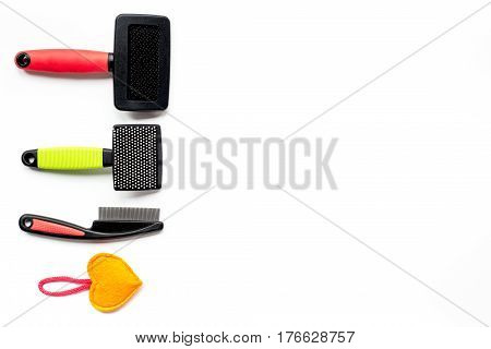 Pet accessory and care set on white table background top view mock-up