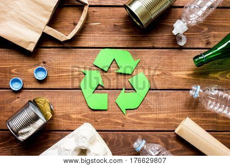 environment concept with recycling symbol for garbage disposal on rustic wooden table background top view