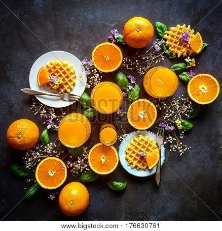 Oranges, orange juice, waffles composition top view knolling