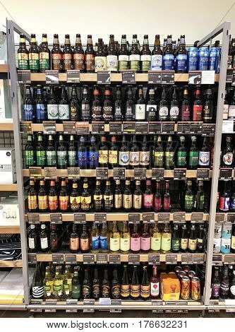 READING - MARCH 12, 2017: Colourful varieties of craft beers, ales and lagers line the shelves of Marks and Spencer (M&S) Simply Food in
