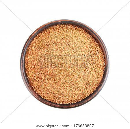 Bowl of coconut sugar on white background