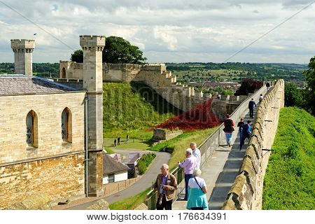 Lincoln Uk - July 1 2016: Unidentified People Walking Along The Castle Walls Of Lincoln Castle A Maj