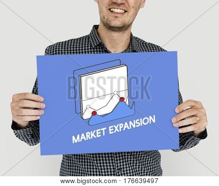 Man holding placard market expansion