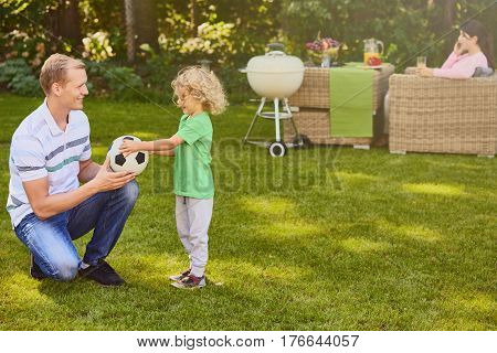 Father And Son Playing Ball