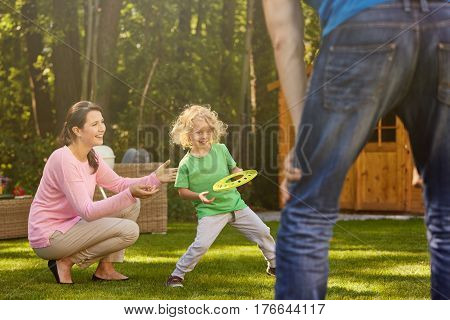Boy In Garden With Parents