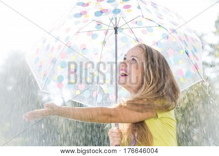 Girl Catching Raindrops