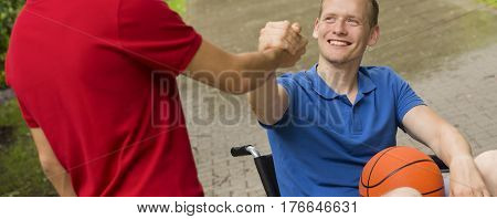 Man On Wheelchair With Basketball