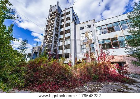 Ruined factory building in abandoned Pripyat city in Chernobyl Exclusion Zone Ukraine