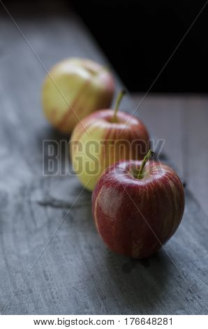 Three small delicious apples on the table
