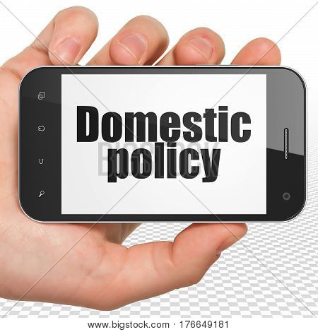 Politics concept: Hand Holding Smartphone with black text Domestic Policy on display, 3D rendering